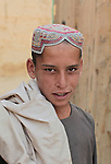 A boy poses for a portrait in the village of Deh-e- Chowkay, in the Arghandab valley near Kandahar, Afghanistan. May 22, 2010. DREW BROWN/STARS AND STRIPES