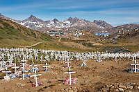 Cemetery with village of Tasiilaq in background, Greenland
