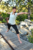 Woman doing yoga in a natural environment