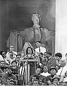 """Washington, D.C. - January 31, 2006 -- Coretta Scott King has passed away in Atlanta, Georgia at age 78.  This file photo, taken in Washington, D.C.  on June 19, 1968 shows Mrs. Martin Luther King (Coretta Scott) addressing some 50,000 marchers at the Lincoln Memorial in the Nation's Capital.  Mrs. King quoted from her late husband's """"I Have a Dream"""" speech delivered from the same spot almost 5 years before..Credit: Arnie Sachs / CNP"""
