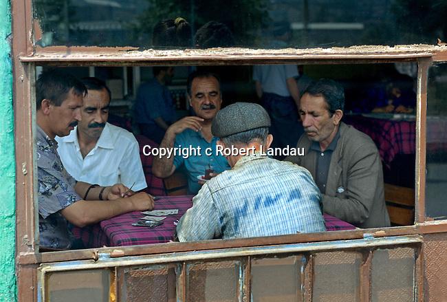 Men play cards in tea houses in Istanbul, Turkey