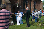 Church Clipping Ceremony St Peters Church Edgmont Shropshire Uk 2015.<br /> <br /> The congregation hold hands, in a circle around the whole of the church, if they can, they did just in 2015, with the use of belts and ropes to complete the unbroken circle.  <br /> <br /> The word &quot;clipping&quot; is Anglo-Saxon in origin, and is derived from the word &quot;clyp-pan&quot;, meaning &quot;embrace&quot; or &quot;clasp&quot; and thus is an expression of devotion.