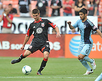 Perry Kitchen (23) of D.C. United goes against Sporting Kansas City Paulo Nagamura (6)  D.C. United tied The Sporting Kansas City 1-1, at RFK Stadium, Sunday May 19, 2013.