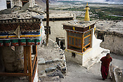 A Buddhist monk walks up to the Diskit Monastery in Nubra Valley in Ladakh, India.