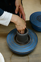 A bizenware pottery lesson at Okayama castle. Okayama, Okayama Prefecture, Japan, October 7, 2015. The southern city of Okayama is well-known for its temperate climate, castle, and the beautiful traditional Korakuen gardens.