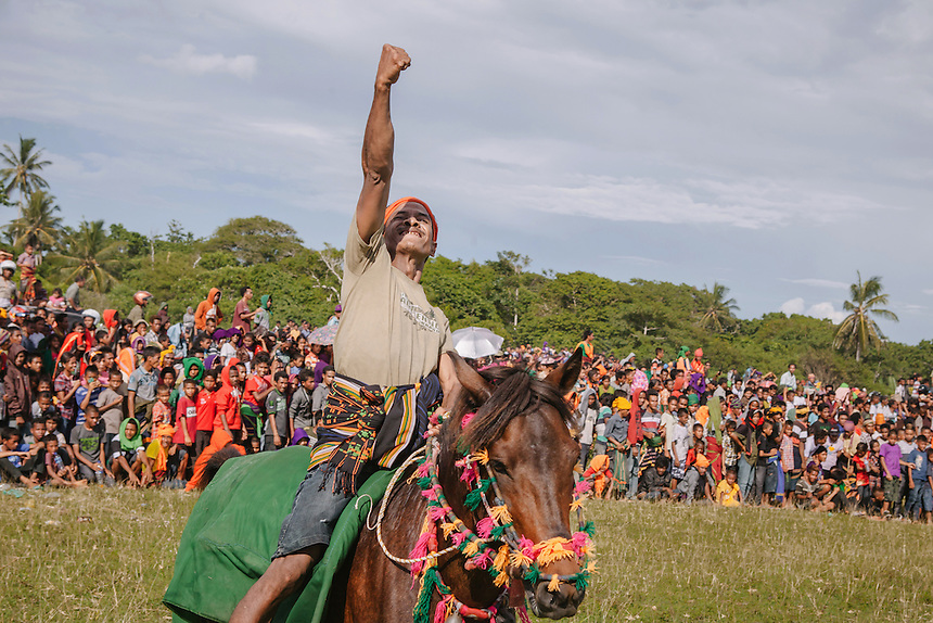 A Pasola warrior celebrates his hit during the event in Bondo Kawango, Kodi. Pasola is an ancient tradition from the Indonesian island of Sumba. Categorized as both extreme traditional sport and ritual, Pasola is an annual mock horse warfare performed in response to the harvesting season. In the battelfield, the Pasola warriors use blunt spears as their weapon. However, fatal accident still do occurs.