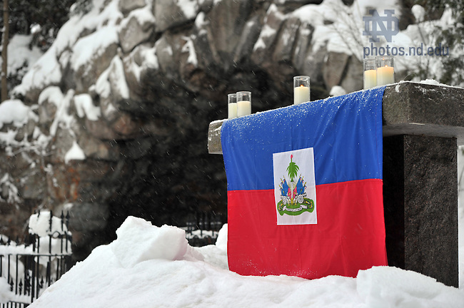 A Haitian flag is draped over the altar at the Grotto for a memorial service marking the 1-year anniversary of the 2010 earthquake...Photo by Matt Cashore/University of Notre Dame