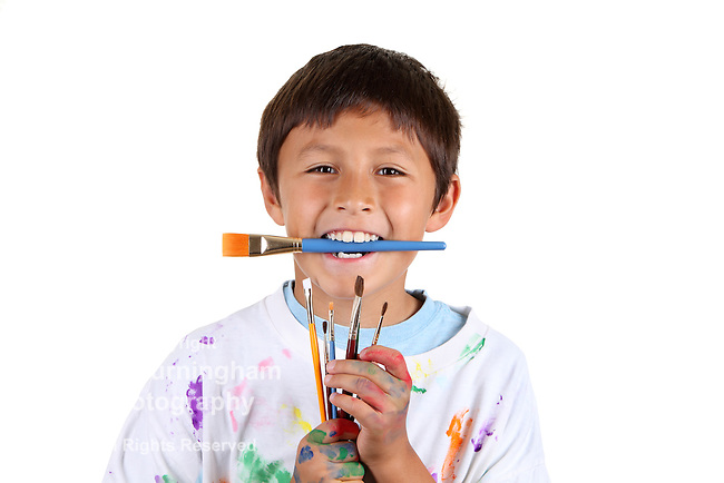Young boy artist on white background