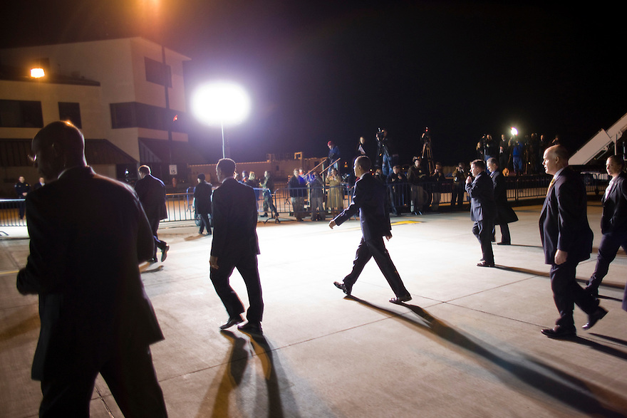 President Barack Obama walks across the tarmac to greet a crowd upon arrival in Springfield, IL...Photo by Brooks Kraft/Corbis........................