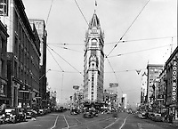 View looking north of Telegraph Ave on the left and Broadway on the right, downtown Oakland, California.<br />(photo 1930's)