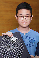 OrigamiUSA 2014 exhibition. Sejin Park with his original origami design of a spider, including the crease pattern and model.