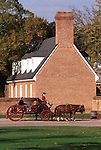 Horse and carriage Williamsburg VA, Colonial carriage, Colonial Williamsburg Virginia, horse drawn carriage, coach, horses clopping, coble stone streets, stage wagon, stable, historic area, Carriage wheel trundle beneath Duke of Gloucester Street, groomed horses, horses with polished harness brass leather for wear, horses to the carriages, blacksmith, harness, coachman, Fine Art Photography by Ron Bennett, Fine Art, Fine Art photography, Art Photography, Copyright RonBennettPhotography.com ©