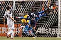 New York Red Bulls forward Thierry Henry (14) and LA Galaxy defender Omar Gonzalez (4) watch LA Galaxy goal keep Donovan Ricketts (1) stretch for a save. The LA Galaxy and Red Bulls of New York played to a 1-1 tie at Home Depot Center stadium in Carson, California on  May 7, 2011....
