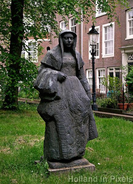 Beeld van een begijntje in het begijnhof in amsterdam holland in pixels - Beeld het meisje van ...