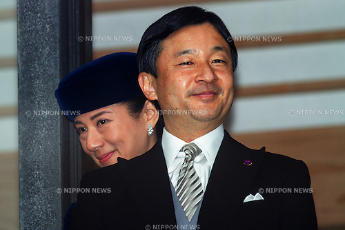 December 23, 2012, Tokyo, Japan - Crown Prince Naruhito, the heir to the Chrysanthemum Throne of Japan, smiles to a throng of well-wishers from behind the bullet-proof glass panel of the Imperial Palace balcony during a general audience in Tokyo on Sunday, December 23, 2012, on the 79th birthday of Emperor Akihoto. With Naruhito is his wife, Princess Masako. (Photo by AFLO) UUK -mis-