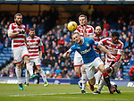Clint Hill wins tbhe short corner from Mikey Devlin and Rakish Bingham