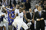 Sophomore guard DeAndre Liggins and junior forward Patrick Patterson cheer after the Cats won 90-60 over the Deacs during the second round of the NCAA tournament at New Orleans Arena on Saturday, March 20, 2010. Photo by Adam Wolffbrandt | Staff