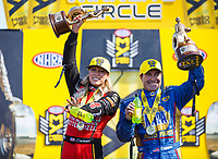 Apr 23, 2017; Baytown, TX, USA; NHRA top fuel driver Leah Pritchett (left) celebrates with funny car teammate Ron Capps after winning the Springnationals at Royal Purple Raceway. Mandatory Credit: Mark J. Rebilas-USA TODAY Sports