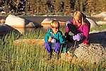 Kids (ages 5 & 9) exploring the shore of Muir Lake, John Muir Wilderness, Sierra Nevada Mountains, California USA