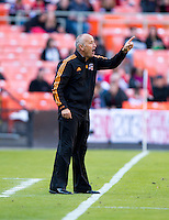 Houston Dynamo head coach Dominic Kinnear yells to his team during a Major League Soccer game at RFK Stadium in Washington, DC. D.C. United vs. Houston Dynamo, 2-1.