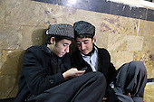BIARA, IRAQ: Two students listen to Koranic songs on their cellphone...The Biara Madrassa--a religious school--is located high up in the mountainous Kurdish Hawraman region that makes up the Iran/Iraq border. Before 2003 the region was home to a fundamentalist Islamic group called Ansar al-Islam who used the school as a base. The Unites States military attacked the area and the madrassa numerous times during the 2003 invasion, finally pushing Ansar al-Islam out...Today the madrassa is home to 48 male students from all across Kurdish Iraq. The students leave their families and immerse themselves in their studies and the daily life of Koranic students...Photo by Besaran Tofiq