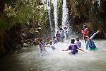 En Gedi. A group of young girls cool off in a pool below the Nachal David waterfalls