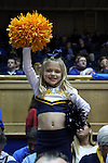 29 December 2014: A young Toledo fan dressed as a cheerleader. The Duke University Blue Devils hosted the University of Toledo Rockets at Cameron Indoor Stadium in Durham, North Carolina in a 2014-16 NCAA Men's Basketball Division I game. Duke won the game 86-69.