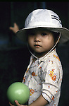 Small child poses with a ball in Hanoi, North Vietnam.  (Jim Bryant Photo).....