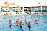 Members of the Sun City Aqua Suns, a synchronized swim team made up of retirees, perform for a crowd at the Holiday Around the World celebration in Sun City, Arizona December 10, 2010...2010 marks the 50th anniversary of Sun City, America's first retirement city that remains the largest today with more than 40,000 residents 55 and older.