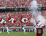 9 September 2006: Fireworks and flags precede the entry of the North Carolina State team onto the field. Akron defeated North Carolina State 20-17 at Carter-Finley Stadium in Raleigh, North Carolina in an NCAA college football game.
