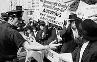 12th Jun 1969. A group of Orthodox Jewish men in New York City protest against the practice of autopsies in Israel.
