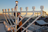 Rabbi Isaac Levitansky, 41, from the Chabad  House, lights the Menorah at the Santa Monica Pier during the first night of Chanukah on Wednesday, December 1, 2010.