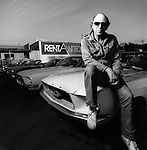 Black and white portrait of Rent A Wreck CEO on lot in Los Angeles.