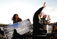 Nov. 13, 2011; Pomona, CA, USA; Connie Worsham (left) looks on as her husband NHRA top fuel dragster driver Del Worsham celebrates after clinching the world championship at the Auto Club Finals at Auto Club Raceway at Pomona. Mandatory Credit: Mark J. Rebilas-.