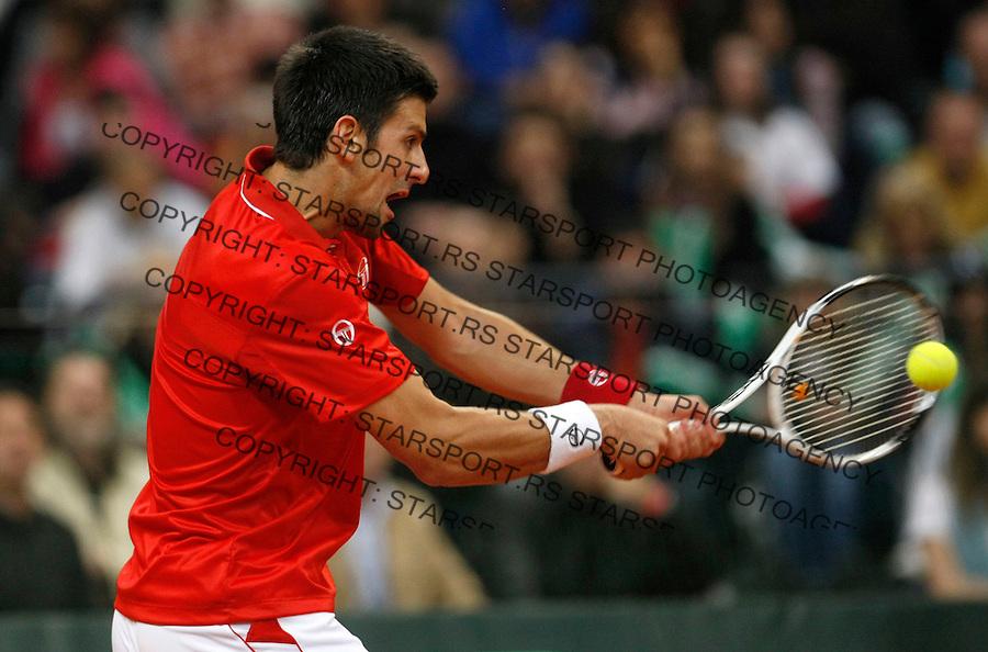 Tenis, Davis Cup 2010.Serbia Vs. USA.Novak Djokovic (SRB) Vs. John Isner (USA).Novak Djokovic, returnes.Belgrade, 07.03.2010..foto: Srdjan Stevanovic/Starsportphoto ©