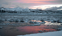The sun sets on Swan Lake Flats after a brief spring snow storm. Yellowstone National Park.