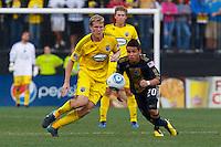 24 OCTOBER 2010:  Columbus Crew midfielder Kevin Burns (15) and Philadelphia Union midfielder Roger Torres (20) during MLS soccer game at Crew Stadium in Columbus, Ohio on August 28, 2010.