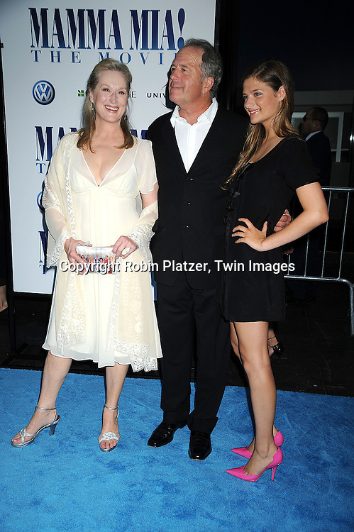 """Meryl Streep and husband Don Gummer and daughter Louisa Gummer..posing for photographers at The American Premiere of """"Mamma Mia! The Movie on July 16, 2008 at The ..Ziegfeld Theatre in New York City. ....Robin Platzer, Twin Images"""