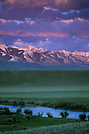 Alpenglow on the Madison Range south of Ennis, Montana with the Madison River flowing past