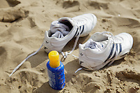 Trainers off, bottle of suntan lotion at the ready: soaking up some winter sunshine on Coral Bay Beach, Cyprus