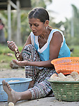A woman sorts corn in Santa Elena, in Guatemala's Peten region.