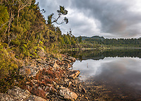 Alpine Lake reflections at cloudy sunset, Westland Tai Poutini National Park, West Coast, South Westland, UNESCO World Heritage Area, New Zealand, NZ