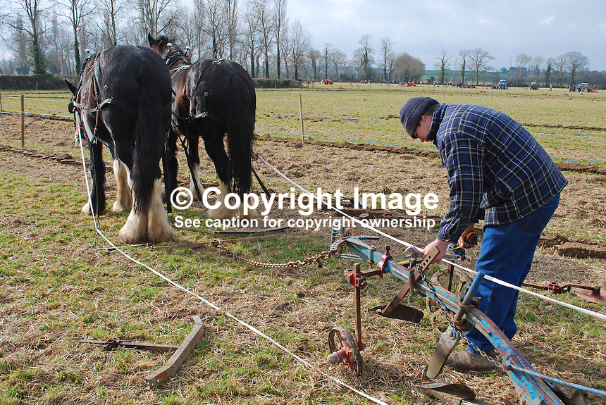Making last minute adjustments to horse plough. Taken 28 February 2009 at 95th annual ploughing match of Mullahead & District Ploughing Society, Co Down, N Ireland, UK, 200902281851..Copyright Image from Victor Patterson, 54 Dorchester Park, Belfast, UK, BT9 6RJ..Tel: +44 28 9066 1296.Mob: +44 7802 353836.Voicemail +44 20 8816 7153.Skype: victorpattersonbelfast.Email: victorpatterson@mac.com.Email: victorpatterson@ireland.com (back-up)..IMPORTANT: If you wish to use this image or any other of my images please go to www.victorpatterson.com and click on the Terms & Conditions. Then contact me by email or phone with the reference number(s) of the image(s) concerned.