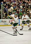 24 October 2015: University of Vermont Catamount Forward Mario Puskarich, a Junior from Fort Walton Beach, FL, takes a  second period goal-assisting shot against the University of North Dakota at Gutterson Fieldhouse in Burlington, Vermont. North Dakota defeated the Catamounts 5-2 in the second game of their weekend series. Mandatory Credit: Ed Wolfstein Photo *** RAW (NEF) Image File Available ***