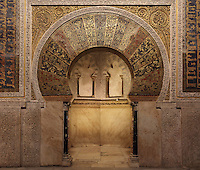 The mihrab portal, a horseshoe arch and rectangular surround or alfiz richly decorated with tesserae (glass mosaic with gold or coloured backing) with vegetal designs and kufic inscriptions, in the Cathedral-Great Mosque of Cordoba, in Cordoba, Andalusia, Southern Spain. The first church built here by the Visigoths in the 7th century was split in half by the Moors, becoming half church, half mosque. In 784, the Great Mosque of Cordoba was begun in its place and developed over 200 years, but in 1236 it was converted into a catholic church, with a Renaissance cathedral nave built in the 16th century. The historic centre of Cordoba is listed as a UNESCO World Heritage Site. Picture by Manuel Cohen