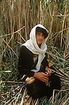 Marsh Arabs. Southern Iraq. Circa 1985. Marsh Arab young man with hunting rifle amongst reed banks.