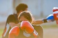 A Peruvian girl practices sparring while training in the outdoor boxing school at the Telmo Carbajo stadium in Callao, Peru, 4 April 2013.