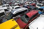 Thousands of cars wrecked by the March 11 quake and tsunami are lined up in a field near the airport in Natori, Miyagi Prefecture, Japan on 14 April, 2011. .Photographer: Robert Gilhooly