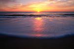 Incoming wave at sunrise, Cape Hatteras National Seashore, North Carolina