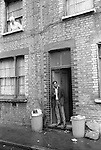 Tower Hamlets East London UK 1978. Bengali man standing in doorway of his home in Princess Street.